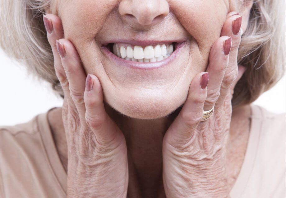Senior Woman with New Dentures Smiling