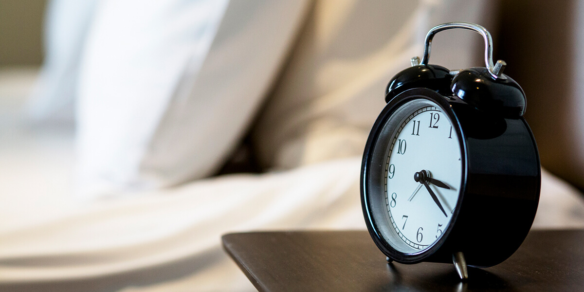 Alarm Clock by Bed Image